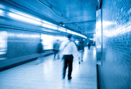 passageway: passengers walking blur with subway passageway in hong kong Stock Photo