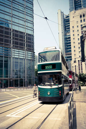 trams: double decker trams in the street of Hong Kong