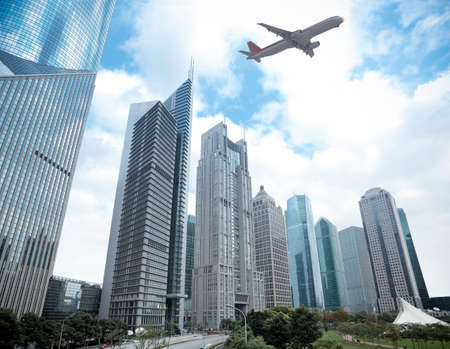 modern building with airplane under the sky in shanghai Stock Photo