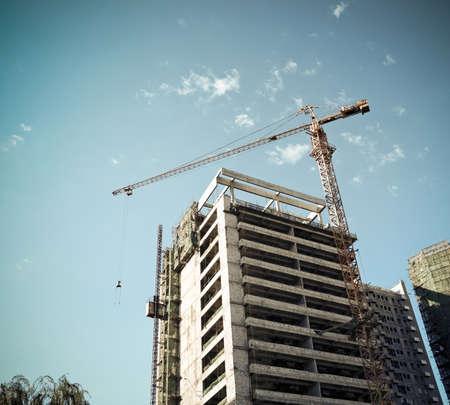 commercial construction: crane on a construction site against sky background