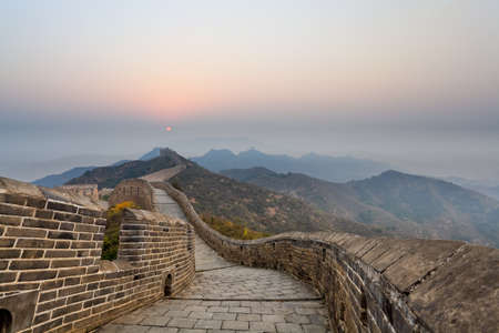 the great wall in ridge mountains at sunrise photo