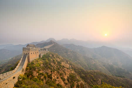 chinese wall: the great wall at sunrise
