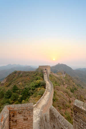 the great wall of china with sunrise background photo