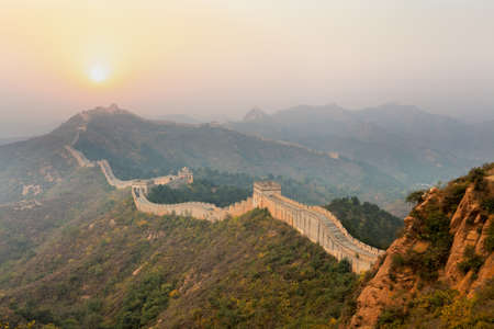 china landscape: the great wall winding in ridge at sunrise Stock Photo