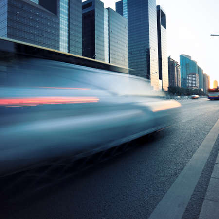 car motion blur at modern city street in dusk Stock Photo - 12672954