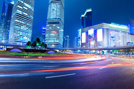 light trails on the modern city in shanghai at night photo