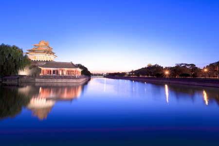 peking: turret of the forbidden city at dusk in beijing,China Stock Photo