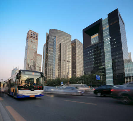 city traffic with modern building background at dusk