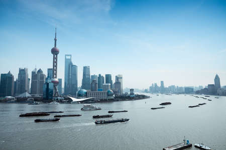 huangpu: shanghai pudong skyline and busy huangpu river Editorial