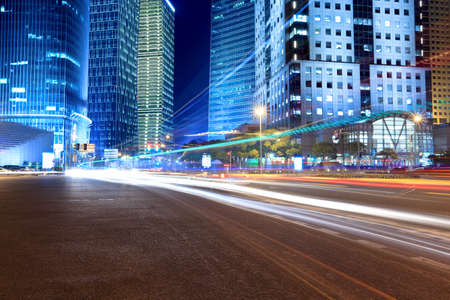 light trails on the street with modern building background in shanghai