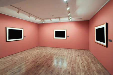 blank picture frame in a room against exhibition wall