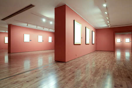 gallery interior: blank picture frame in art gallery Editorial