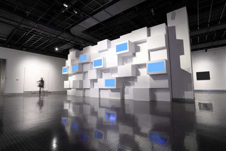 art exhibition: video wall and a picture frame in a exhibition room