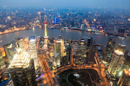 shanghai china: aerial view of shanghai at dusk from world financial center
