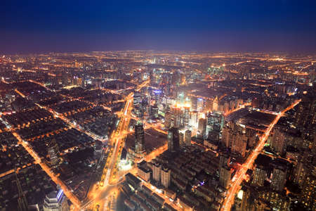 aerial view of the bright lights of the metropolis at night in shanghai photo