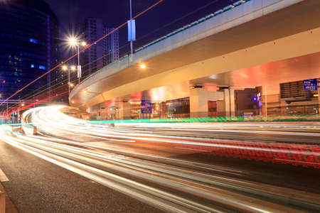 light trails on city highway and viaduct at night in shanghai photo