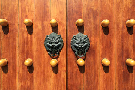 chinese traditional wooden door with beast head knocker  photo