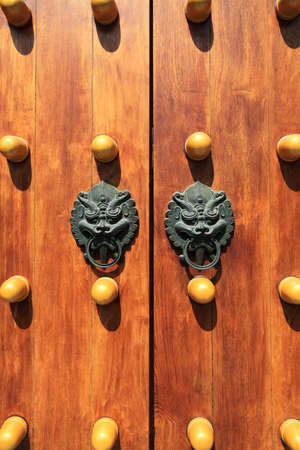 chinese traditional wooden door with beast head knocker  Stock Photo - 12947522
