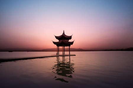 nightfall: pavilion at nightfall,the west lake in hangzhou,China
