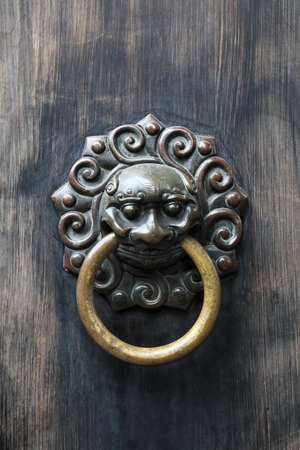 ancient knocker on traditional door photo