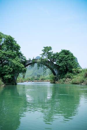 pastoral: old stone bridge in yangshuo,one pastoral scenery