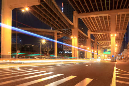 interchange: light trails under the grade separation bridge in shanghai