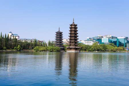 golden and silver pagoda in banyan lake,guilin,China Stock Photo - 13452884