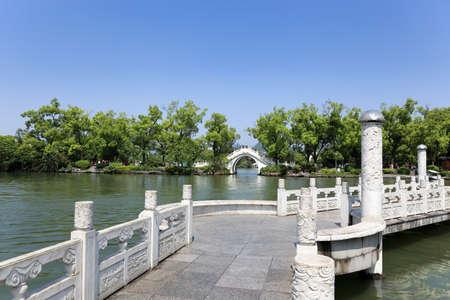 guilin: stone arch and zigzag bridge at banyan lake in guilin,China