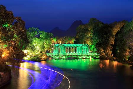 banyan tree: night scene of the glass bridge at banyan lake in guilin,China