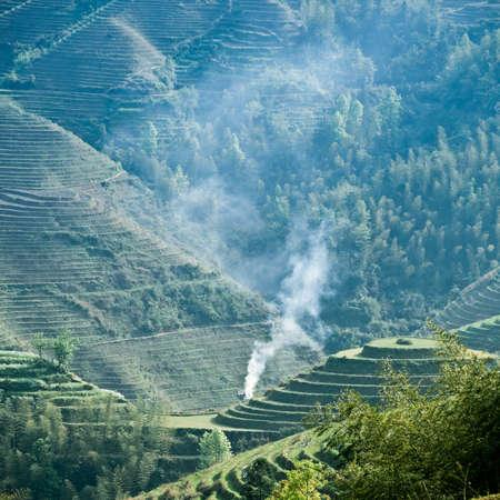green terraced field and smoke,beautiful countryside scenery photo