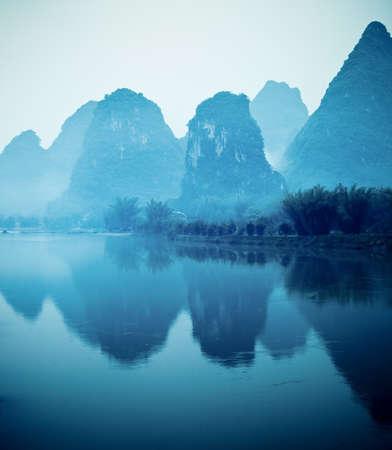 guilin: beautiful yangshuo hills and reflection in lijiang river Stock Photo
