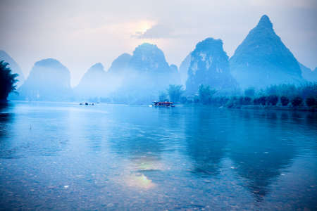 tourist destination: karst hills scenery at sunrise, a famous tourist destination in yangshuo,guilin,China