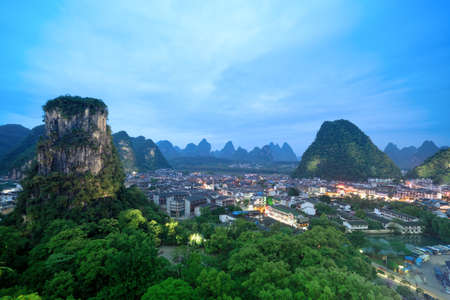 foothill: yangshuo county town at night,beautiful karst mountain landscape in guilin, China