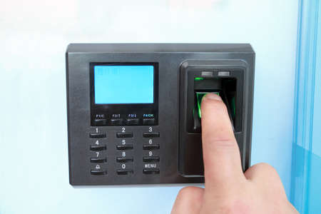 access: fingerprint and password lock in a office building Stock Photo