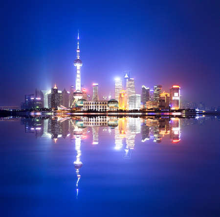 huangpu: shanghai skyline at night,and reflection in the huangpu river