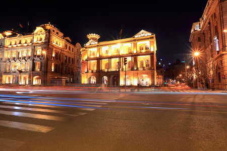 beautiful night view of shanghai  the bund  ,light trails on the street with classical buildings photo