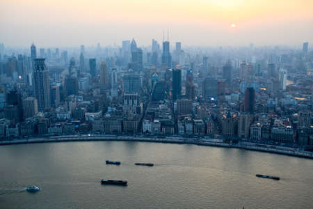 aerial view of shanghai bund at sunset from the oriental pearl tv tower  photo