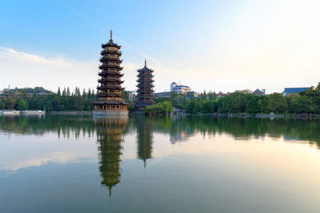 banyan: twin pagodas in banyan lake,guilin, China