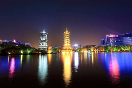 twin pagodas in guilin banyan lake at night with reflection photo