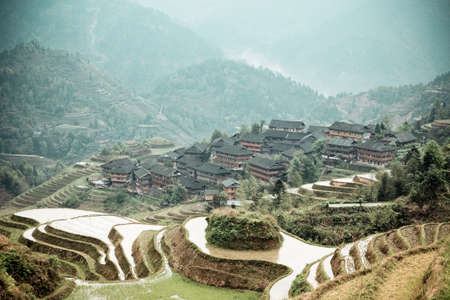 fairyland: chinese terraces and ethnic minority village in springtime,cloud and mist curl up the fairyland Stock Photo