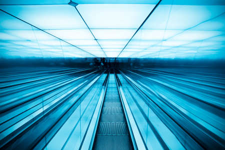 moving escalator in modern building,abstract space photo