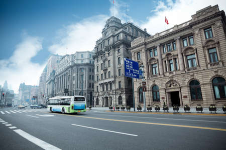 historical buildings with modern street in shanghai bund,China photo