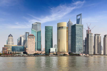 river scape: shanghai lujiazui financial and trade center with blue sky