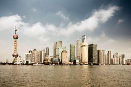 shanghai lujiazui financial center with huangpu river under the sky photo