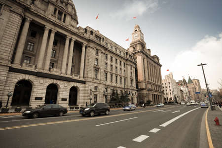 old buildings with modern street in shanghai bund,China photo