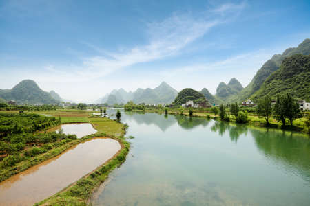 landform: beautiful rural scenery of yangshuo, the yulong river with karst landform