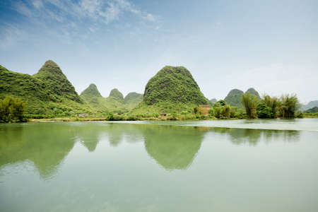 beautiful karst landform with rural scenery in yangshuo, China  photo