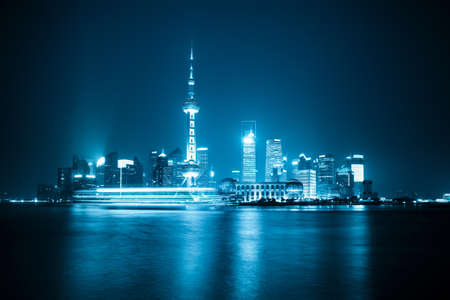 shanghai skyline at night with blue tone photo