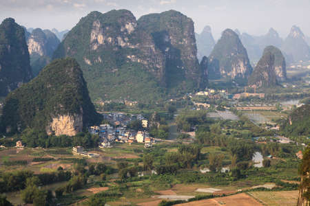 beautiful karst mountain landscape at dusk in yangshuo,China photo