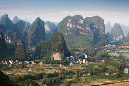 guilin: chinese rural scenery of karst mountain at dusk in yangshuo